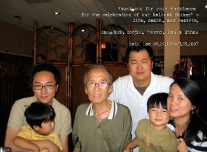 Soo is on the right holding one of her two children. Her Dad is in the center.